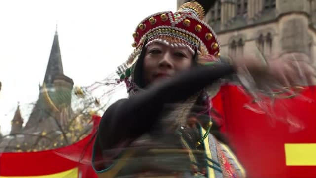 Chinese President Xi Jinping visits Manchester ENGLAND Manchester EXT Various of woman in traditional dress dancing in street as awaiting the arrival...