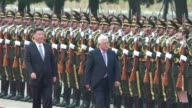 Chinese President Xi Jinping welcomes his Palestinian counterpart Mahmud Abbas during a ceremony in Beijing