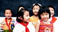 Chinese school children singing together