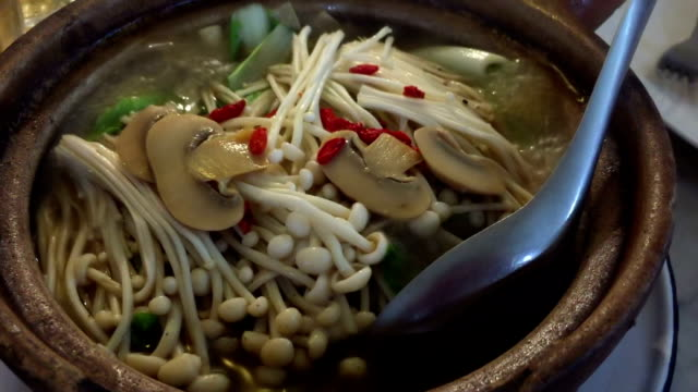 Chinese soup boiling in a pot