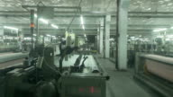 Chinese textile factory interior and machines working scene