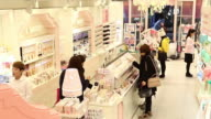 Chinese tourists browse cosmetics at Amorepacific Corp Etude House store in the Myeongdong shopping district in Seoul South Korea on Monday Feb 16...