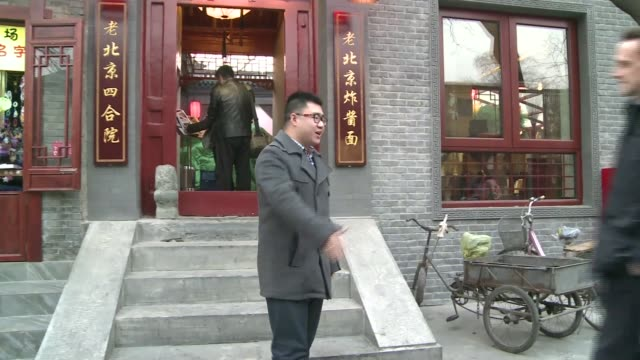 Chinese view of Donald Trump as new US President Beijing Man along with ladder Children in hutong street Zhao Juecheng greeting reporter and into...