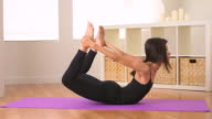 Chinese woman doing yoga: Bow