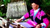 Chinese women weaving in longsheng