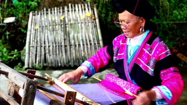Chinese women weaving in longsheng