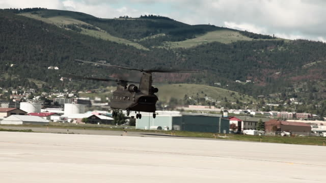 CH-47 Chinook Helicopter at an airfield.