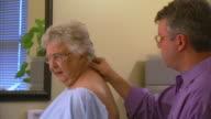 CU Chiropractor examining patient, Head of St. Margaret's Bay, Nova Scotia, Canada