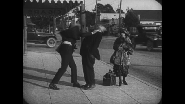 Chivalrous Buster Keaton gets punched in the nose defending woman, before knowing the man out and running away