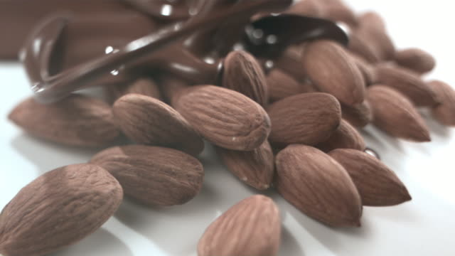 MS SLOW MOTION Chocolate being poured over almonds/ New York, New York