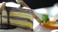 Chocolate cake with chocolate cream at coffee cafe