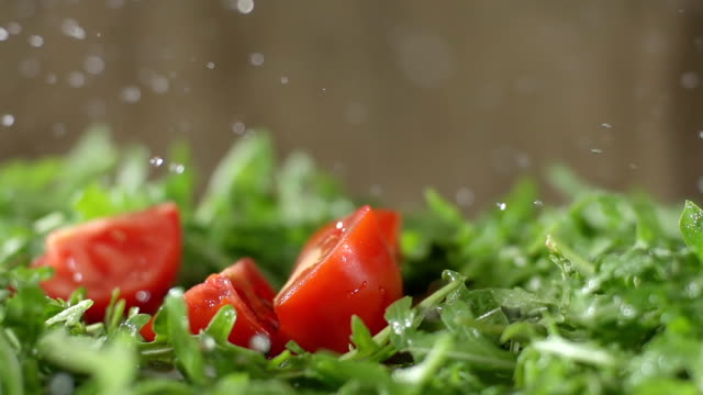 SLO MO Chopped Tomato Falls On Arugula