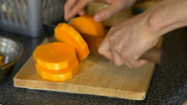 chopping butternut squash