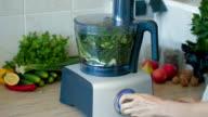 Chopping fresh greens in blender for hash