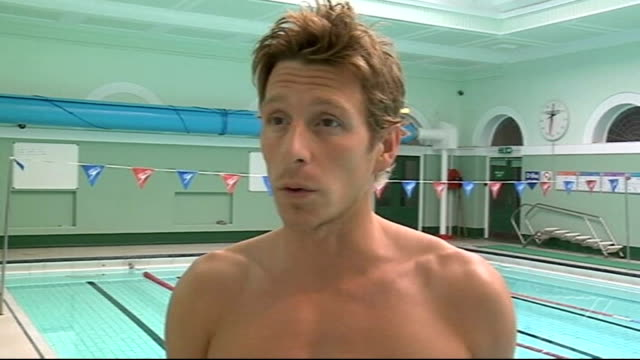 Newcastle INT Chris Cook diving into pool then swimming Chris Cook interview SOT Would be great to win in Beijing Cook showing medal Cook swimming...