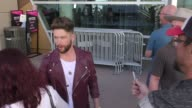 Chris Lane at the ACM Awards Radio Row at TMobile Arena on April 01 2017 in Las Vegas Nevada