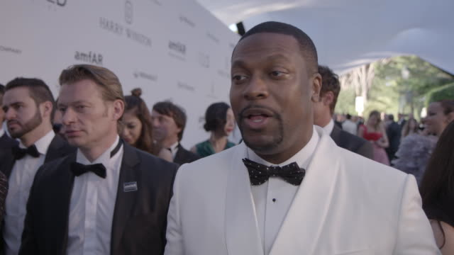 INTERVIEW Chris Tucker on being at amfAr on the auction on Village People and on being in Cannes at amfAR's 23rd Cinema Against AIDS Gala Arrivals at...