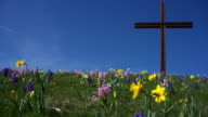 Christ Cross on Flower Covered Hill in Spring