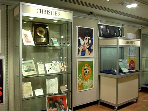 Christie's rock and pop memorabilia auction More of rock and pop memorabilia exhibited people browsing catalogue