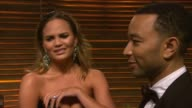 INTERVIEW Christine Teigen and John Legend at the 2014 Vanity Fair Oscar Party Hosted By Graydon Carter Arrivals on March 02 2014 in West Hollywood...