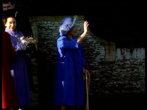 Christmas at Sandringham/ Christmas message EXT Sandringham MS Queen and Queen Mother as Queen moves away and Queen Mother waves and leans on two...