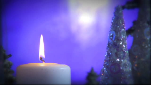 Christmas Candle in Moonlit Forest - Close Up