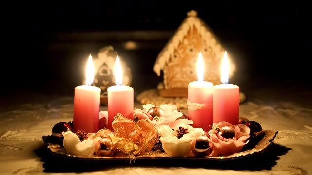 Christmas candles and gingerbread houses on the table
