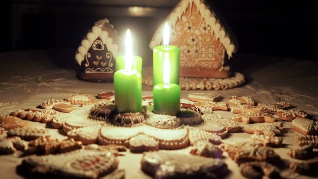 Christmas candles and gingerbreads on the table