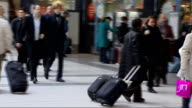 Christmas getaway begins ENGLAND London Liverpool Street Station INT Train passengers with bags on train station concourse Vox pops