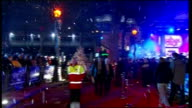 Christmas lights season begins in London Leicester Square Reporter to camera CUTAWAYS of general views of people singing 'O Come All Ye Faithful' as...