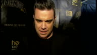 Robbie Williams interview ENGLAND London Oxford Street EXT Robbie Williams interview SOT on how cold it is on having a number one single on honour of...