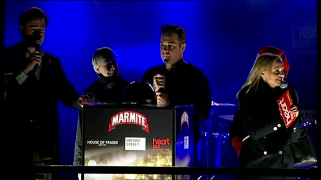 Robbie Williams turning on Oxford Street lights ENGLAND London Oxford Street Robbie Williams on stage for turning on of the Oxford Street lights /...