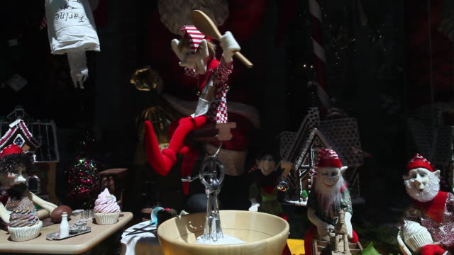 MS Christmas shopping window display with elves in Old Montreal / Montreal, Quebec, Canada