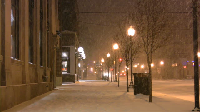 Christmas time winter weather. Snowstorm, snowflakes, snow, snowing. Urban scene.