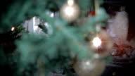 Christmas Tree by a Fireplace. HD