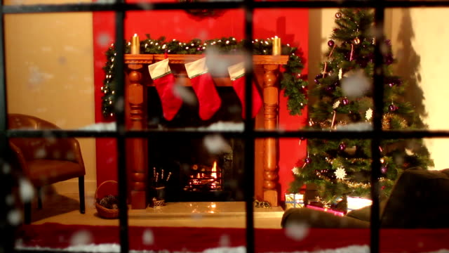 Christmas Tree, fireplace scene through window, Snow falling - Dolly