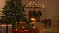 MS, ZI, Christmas tree surrounded with presents in decorated living room with fireplace
