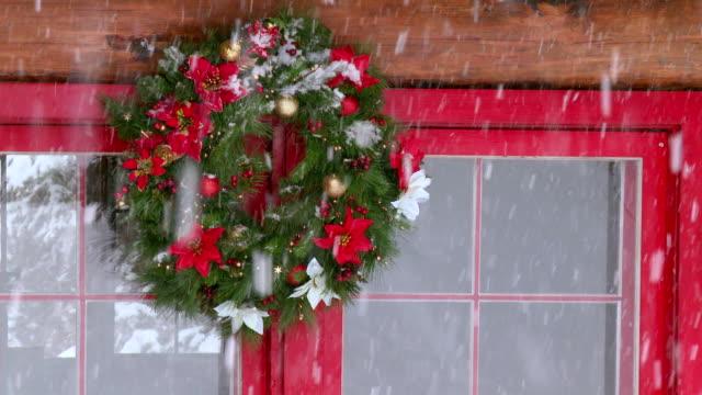 CU Christmas wreath hanging on window during winter / Tweed, Ontario, Canada