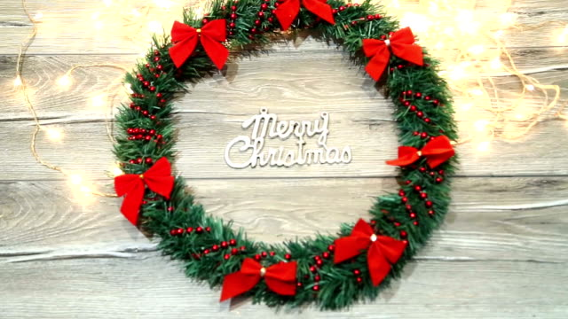Christmas wreath with decorations on the shabby wooden background