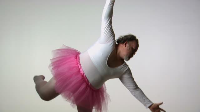Chubby man in tutu ballet dancing