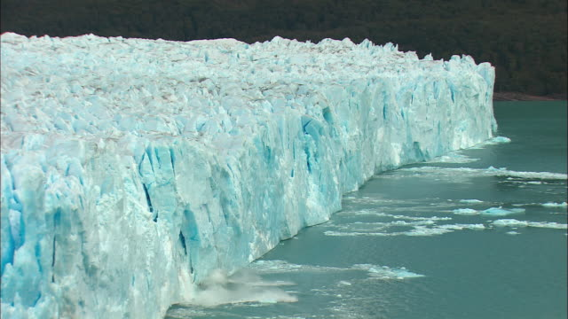 MS, HA, Chunk of ice from Perito Moreno Glacier falling into water, Los Glaciares National Park, Patagonia, Argentine