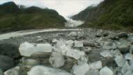 WS Chunks of Glacial Ice with Glacier in Background / Franz Josef Glacier, New Zealand