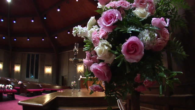 Church Ceremony Pan up with Beautiful Flower Bouquet
