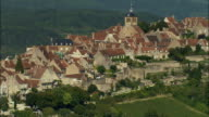 AERIAL WS ZO Church near Basilique Ste-Madeleine in town atop hill with surrounding landscape / Vezelay, France