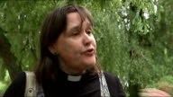 Church of England General Synod votes in favour of ordaining women bishops EXT Woman popping open champagne bottle as another holds up tea towel...