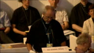 Church of England General Synod votes in favour of ordaining women bishops INT Man speaking at podium for 'The General Synod' High angle view people...