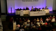 Church of England General Synod votes in favour of ordaining women bishops York INT High angle view synod meeting Clergyman speaking at lectern