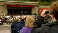 Church of Scotland faces split over ordination of gay clergy EXT **Music heard SOT** Singer on stage at General Assembly day out People watching...