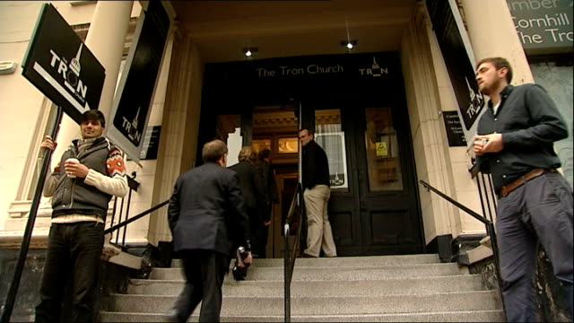 Church of Scotland faces split over ordination of gay clergy SCOTLAND Glasgow EXT Low angle view man speaking into microphone outside church as...