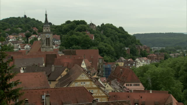 A church steeple dominates the skyline of a German village. Available in HD